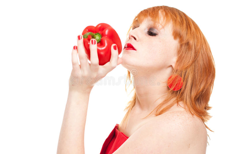 Model smelling red pepper stock photo