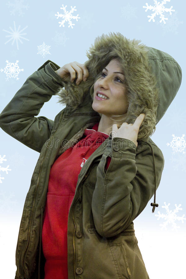 Model with snowflakes. A model work with snowflakes and a gradient blue - white background behind it stock images