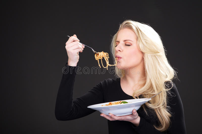 Model with spagetti. Young blonde woman model with spagetti stock photos