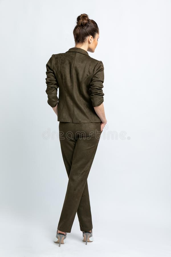 Model in swamp jacket and trousers isolated on white background. royalty free stock image