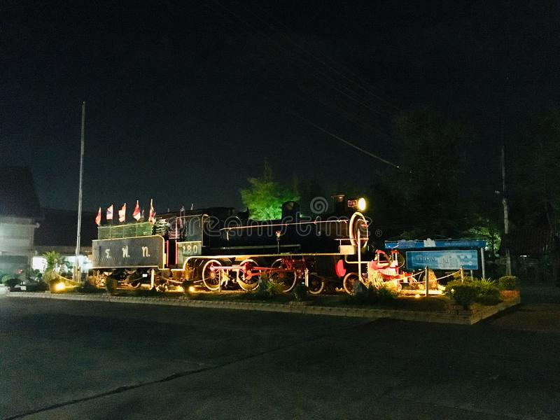 Model Thai old steam train in night scene. Model Thai old steam train in front of station, night scene royalty free stock image