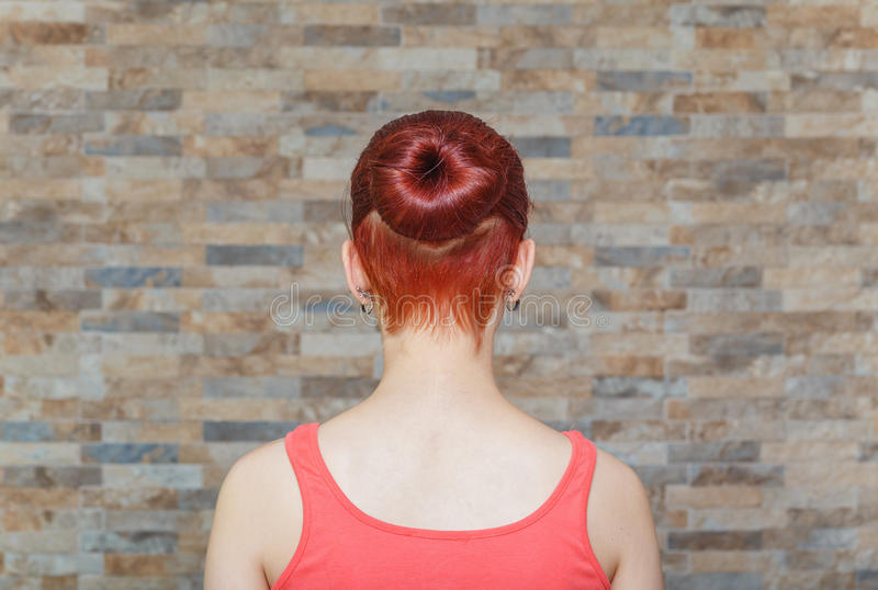 Model with topknot and hidden undercut. Young model with topknot and hidden undercut on hair royalty free stock photo