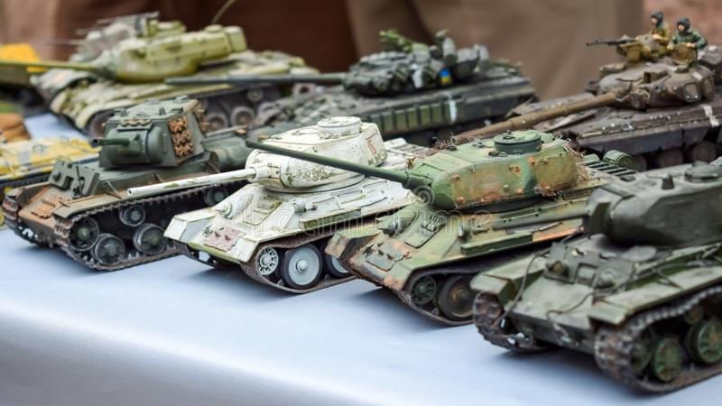 Model toy miniature Soviet Tanks. Various camouflage Military Tank panzer models. On table royalty free stock photos