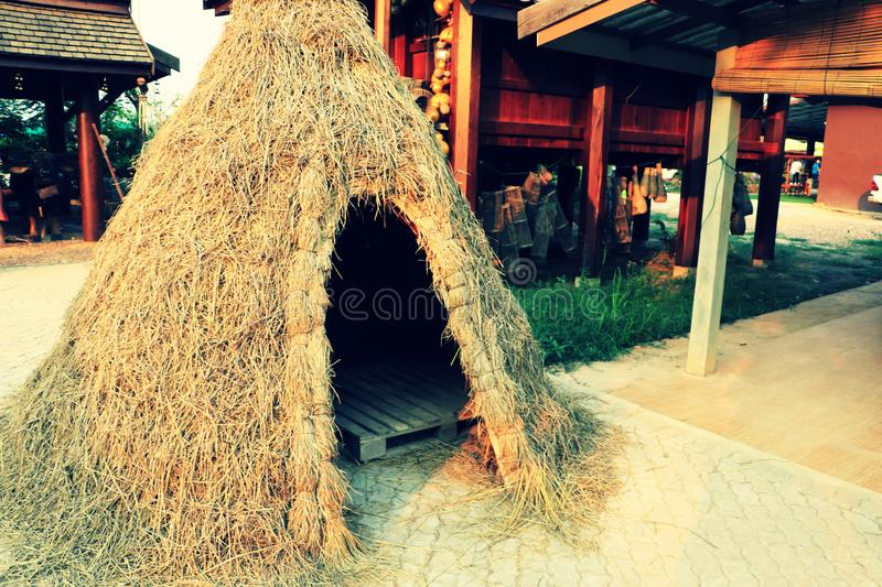 A model of traditional temporary straw hut used as storage shed in the rice field. At cultural park stock photo