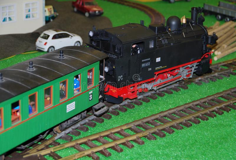 Model train with steam locomotive and old passenger car royalty free stock photography