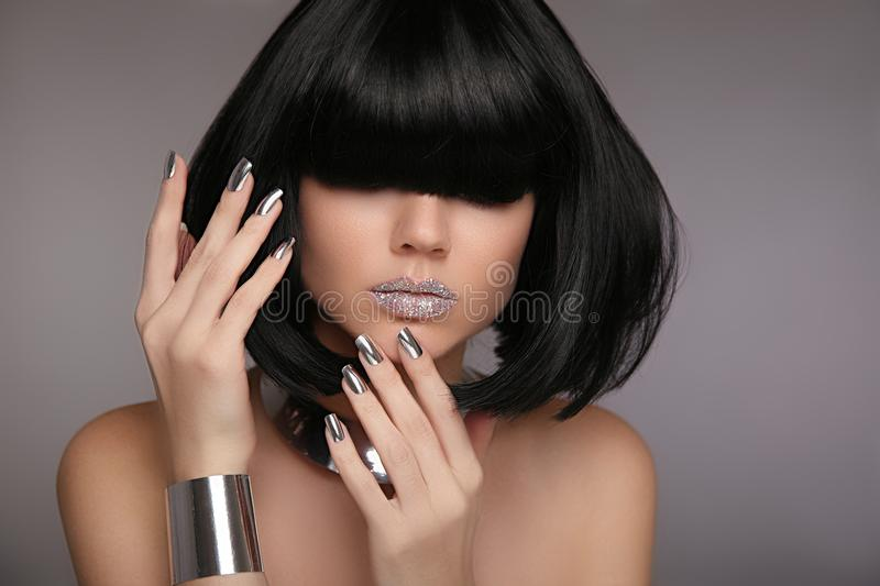 Model with unrecognizable face, glitter lips and black shiny hair. Woman bob haircut styling. Beauty Makeup, Silver Manicured pol. Ish nails. Bob hairstyle royalty free stock photo