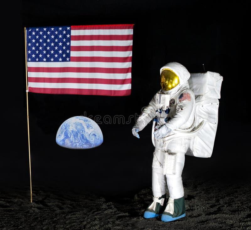 Model van astronaut en van de V.S. vlag voor vertoning royalty-vrije stock afbeeldingen