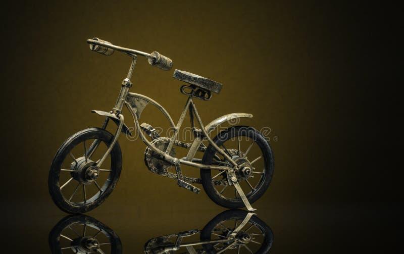 Model van brons uitstekende fiets stock foto's