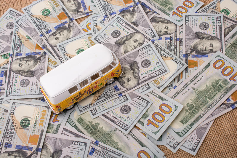 Model van placed US dollar banknotes. Spread on ground royalty free stock images