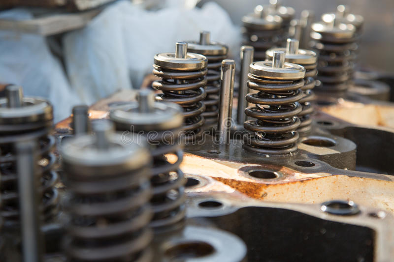 Model of a vehicle engine, engine exhaust valve and intake valve, spring valve of the engine and auto spare parts, machine parts royalty free stock photos