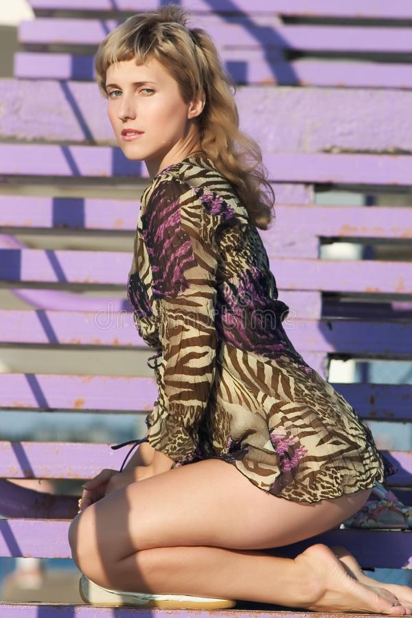 Model on violet stairs stock photography
