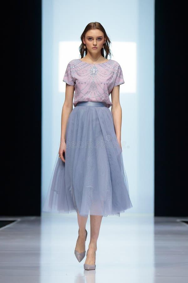 Model walk runway for FABERLIC by VALENTIN YUDASHKIN catwalk at Autumn-Winter 2017-2018 Moscow Fashion Week. royalty free stock image