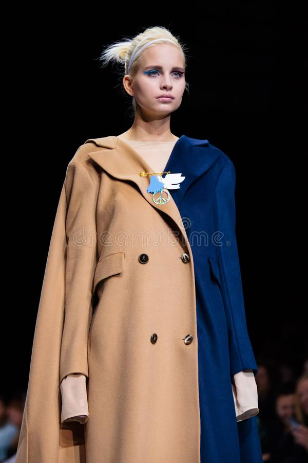 Model walk runway for VICTORIA ANDREYANOVA catwalk at Autumn-Winter 2017-2018 Moscow Fashion Week. royalty free stock photo