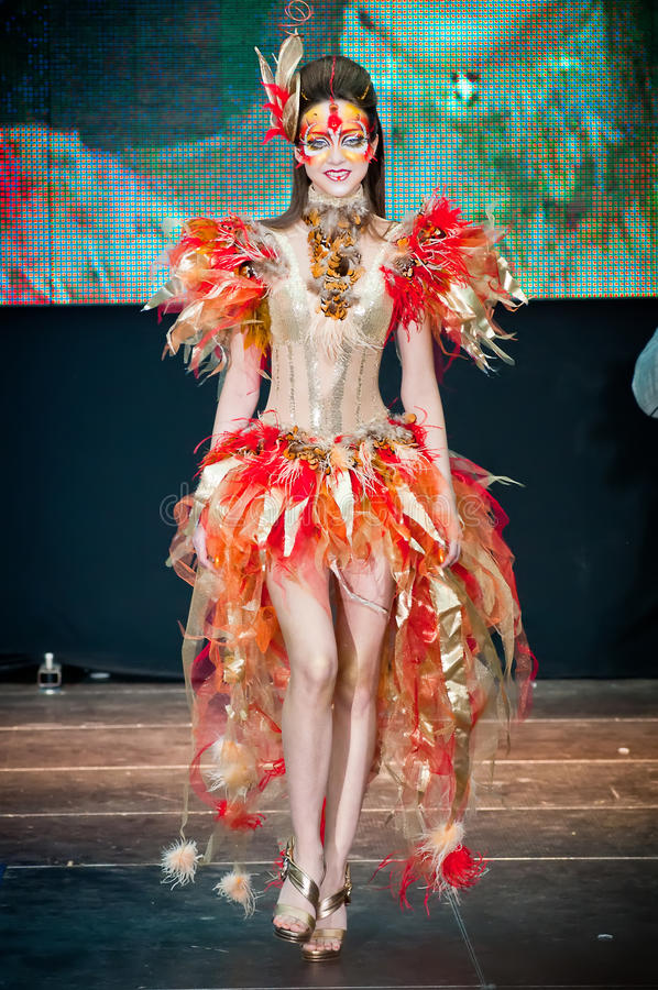 Model walks the runway during stock photography
