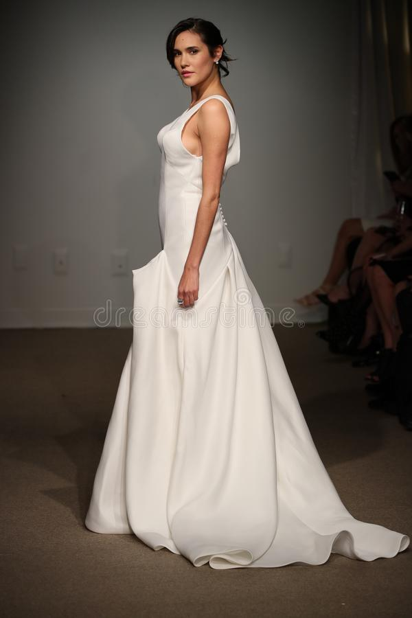 A model walks the runway during the Anna Maier / Ulla-Maija Spring 2019 Bridal fashion show. NEW YORK, NY - APRIL 14: A model walks the runway during the Anna royalty free stock photos