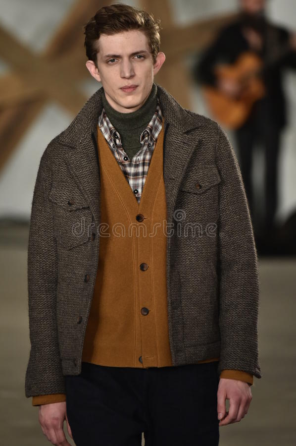 A model walks the runway at the Billy Reid fashion show during New York Fashion Week Men's Fall/Winter 2016. NEW YORK, NY - FEBRUARY 03: A model walks the runway royalty free stock photo