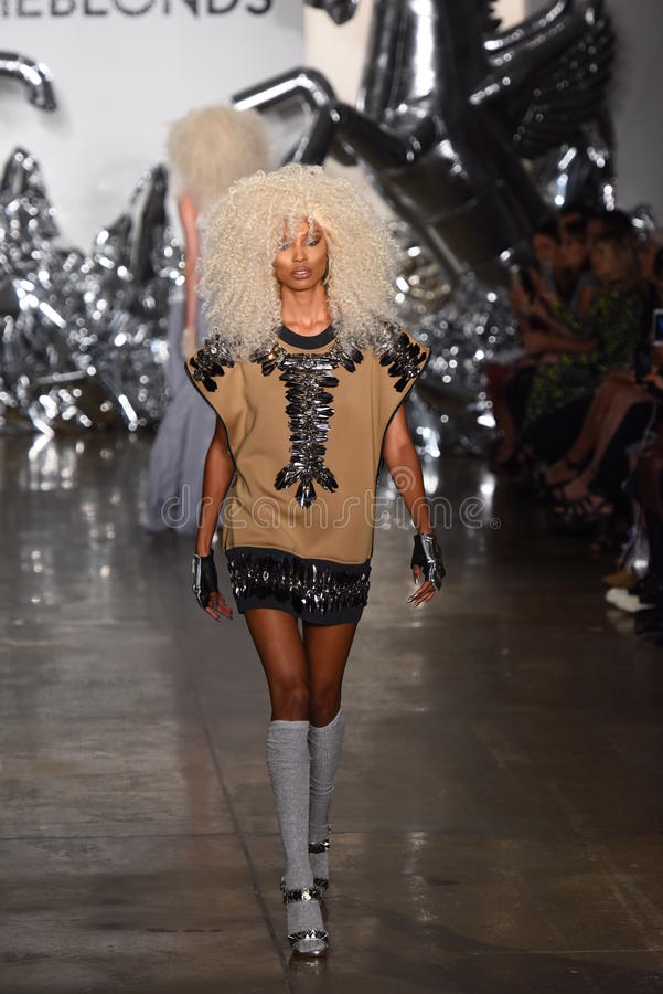 A model walks the runway at The Blonds fashion show royalty free stock photo