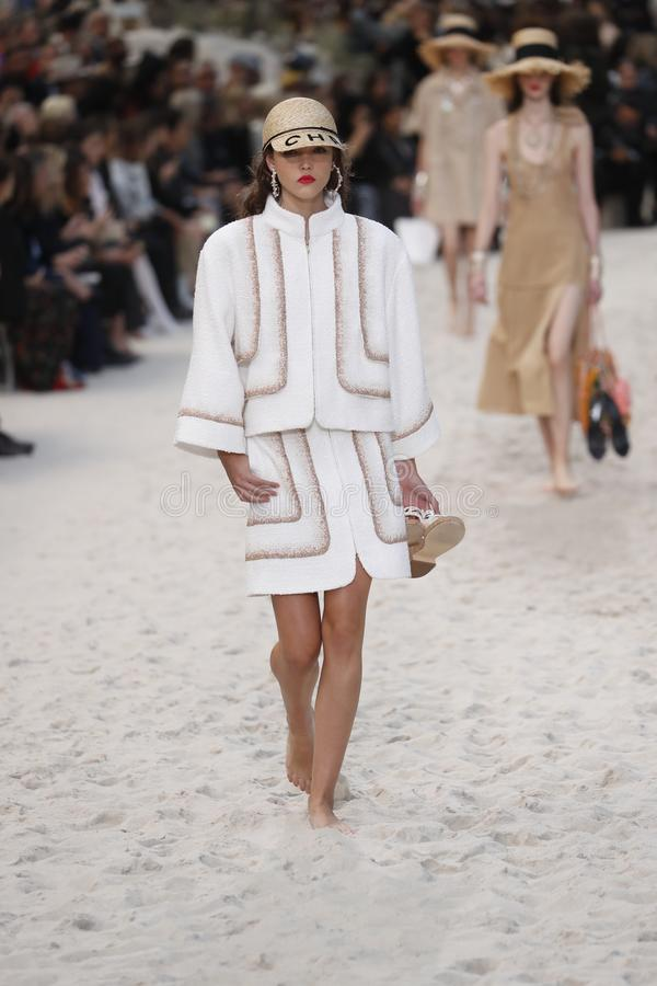 A model walks the runway during the Chanel show as part of the Paris Fashion Week Womenswear Spring/Summer 2019. PARIS, FRANCE - OCTOBER 02: A model walks the royalty free stock images