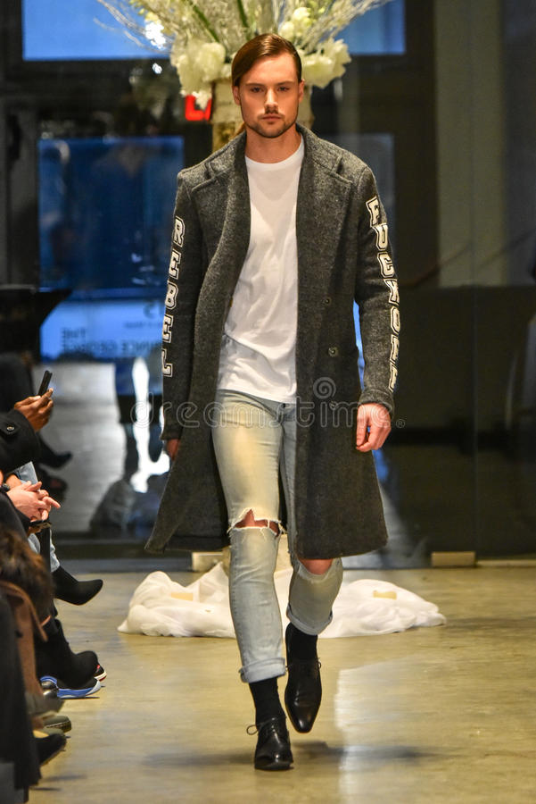 A model walks the runway at the Christopher Lowman Menswear FALL 2017 Collection. NEW YORK, NY - JANUARY 30: A model walks the runway at the Christopher Lowman stock photography