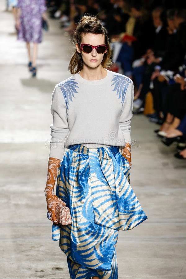 A model walks the runway during the Dries Van Noten show. PARIS, FRANCE - SEPTEMBER 30: A model walks the runway during the Dries Van Noten show as part of the royalty free stock images