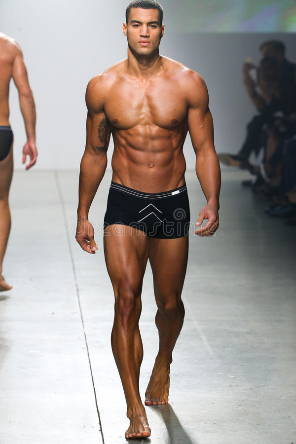 A model walks the runway during 2(X)IST Men's Spring/Summer 2016 Runway Show. NEW YORK, NY - OCTOBER 14: A model walks the runway during 2(X)IST Men's Spring/ stock photo
