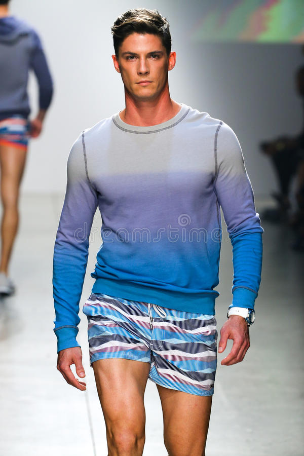 A model walks the runway during 2(X)IST Men's Spring/Summer 2016 Runway Show royalty free stock image