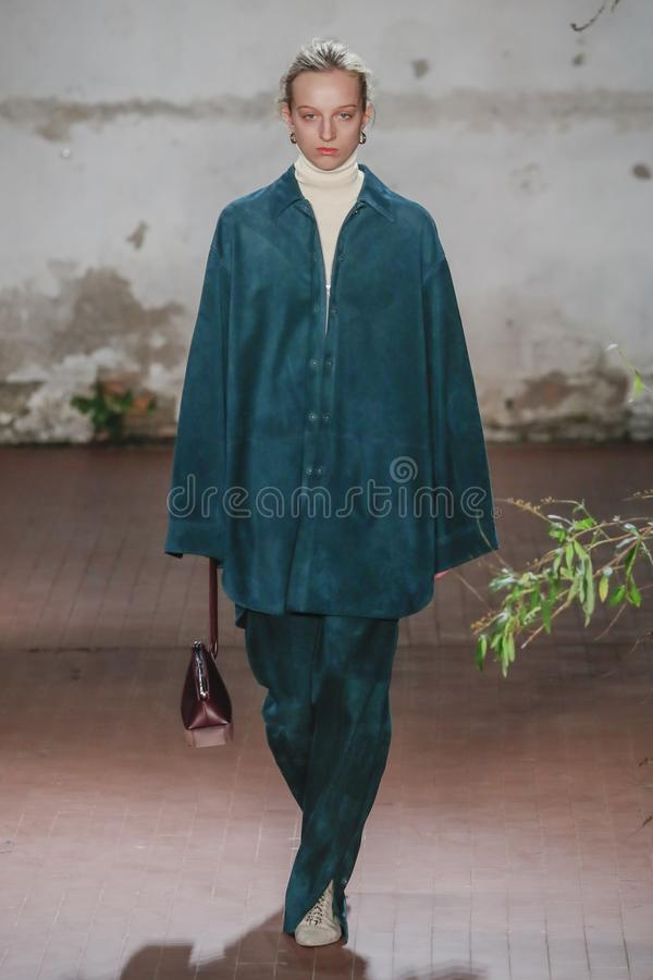 A model walks the runway at the Jil Sander show at Milan Fashion Week Autumn/Winter 2019/20. MILAN, ITALY - FEBRUARY 20: A model walks the runway at the Jil stock image