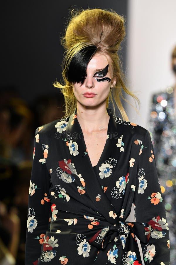 A model walks the runway for Libertine during New York Fashion Week. NEW YORK, NEW YORK - SEPTEMBER 11: A model walks the runway for Libertine during New York royalty free stock photography