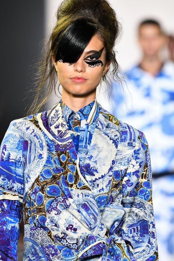 A model walks the runway for Libertine during New York Fashion Week. NEW YORK, NEW YORK - SEPTEMBER 11: A model walks the runway for Libertine during New York royalty free stock image