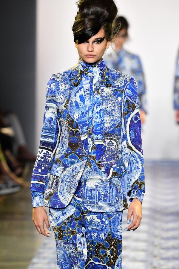 A model walks the runway for Libertine during New York Fashion Week. NEW YORK, NEW YORK - SEPTEMBER 11: A model walks the runway for Libertine during New York stock image