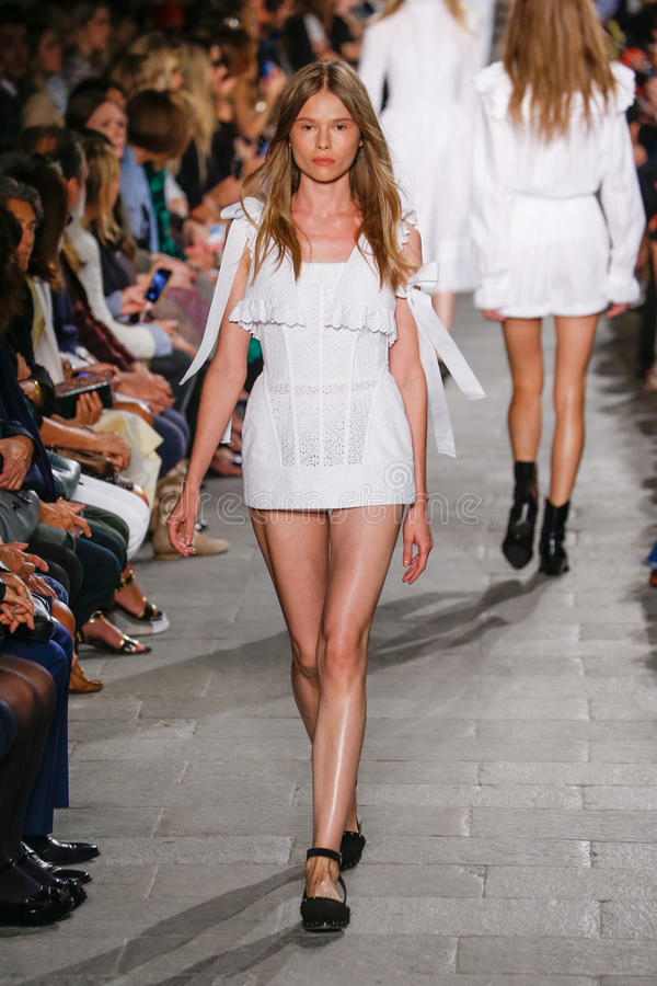 A model walks the runway during the Philosophy di Lorenzo Serafini fashion show. MILAN, ITALY - SEPTEMBER 25: A model walks the runway during the Philosophy di royalty free stock image