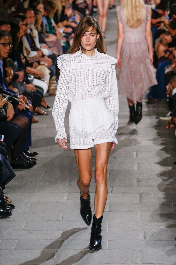 A model walks the runway during the Philosophy di Lorenzo Serafini fashion show. MILAN, ITALY - SEPTEMBER 25: A model walks the runway during the Philosophy di royalty free stock photography