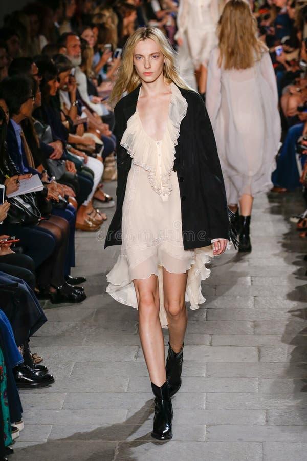 A model walks the runway during the Philosophy di Lorenzo Serafini fashion show. MILAN, ITALY - SEPTEMBER 25: A model walks the runway during the Philosophy di stock photos