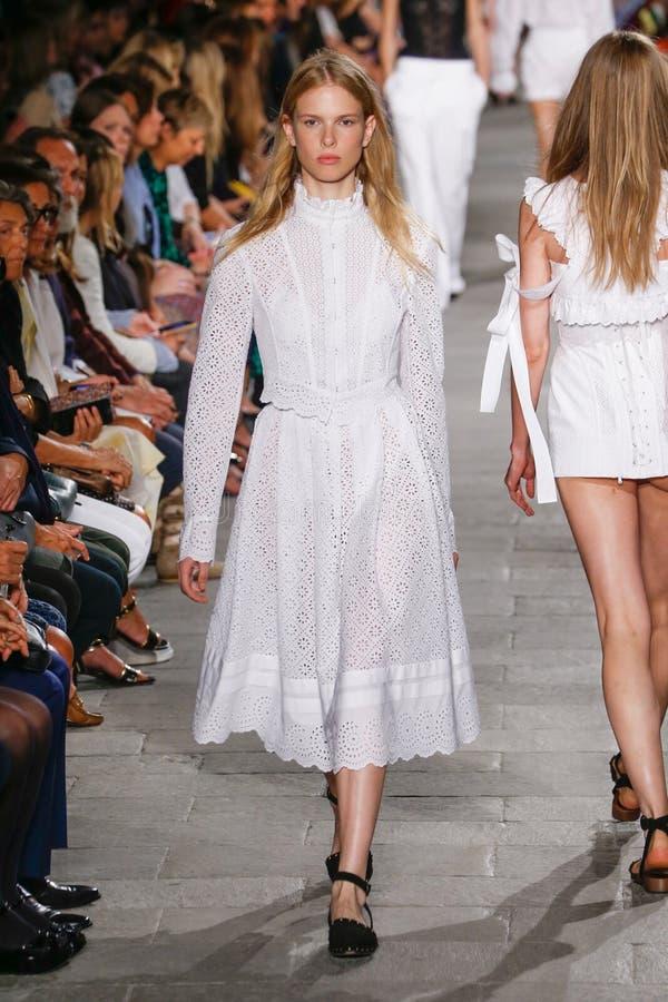 A model walks the runway during the Philosophy di Lorenzo Serafini fashion show. MILAN, ITALY - SEPTEMBER 25: A model walks the runway during the Philosophy di stock image