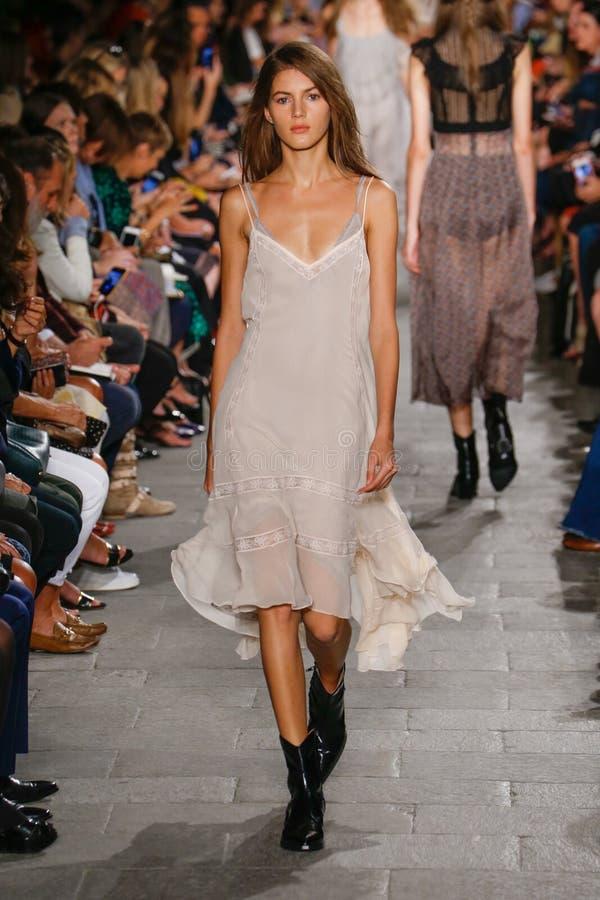A model walks the runway during the Philosophy di Lorenzo Serafini fashion show. MILAN, ITALY - SEPTEMBER 25: A model walks the runway during the Philosophy di stock photography