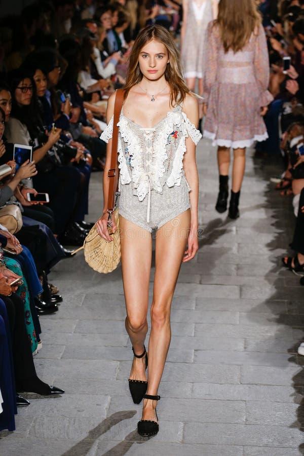 A model walks the runway during the Philosophy di Lorenzo Serafini fashion show. MILAN, ITALY - SEPTEMBER 25: A model walks the runway during the Philosophy di royalty free stock photos