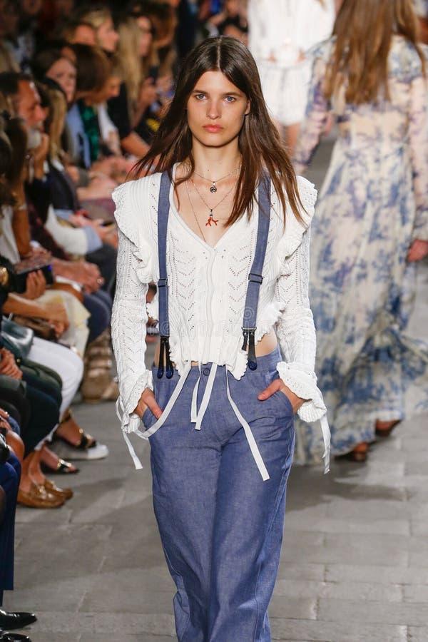 A model walks the runway during the Philosophy di Lorenzo Serafini fashion show. MILAN, ITALY - SEPTEMBER 25: A model walks the runway during the Philosophy di stock images