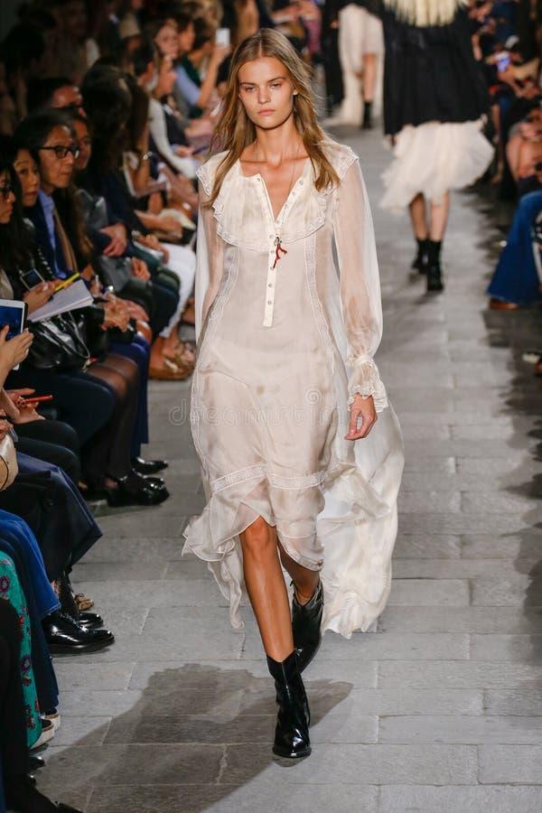 A model walks the runway during the Philosophy di Lorenzo Serafini fashion show. MILAN, ITALY - SEPTEMBER 25: A model walks the runway during the Philosophy di stock photo