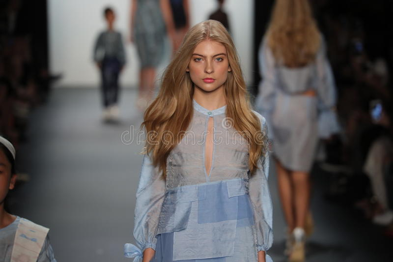 A model walks the runway at the Vicky Zhang Parent Child Collection S/S 2017. NEW YORK, NY - SEPTEMBER 10: A model walks the runway at the Vicky Zhang Parent royalty free stock photo