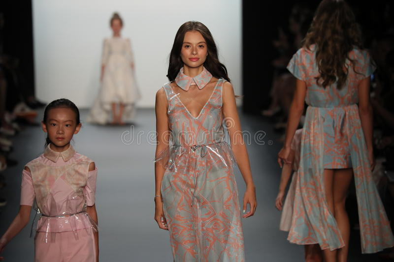 A model walks the runway at the Vicky Zhang Parent Child Collection S/S 2017. NEW YORK, NY - SEPTEMBER 10: A model walks the runway at the Vicky Zhang Parent stock photo