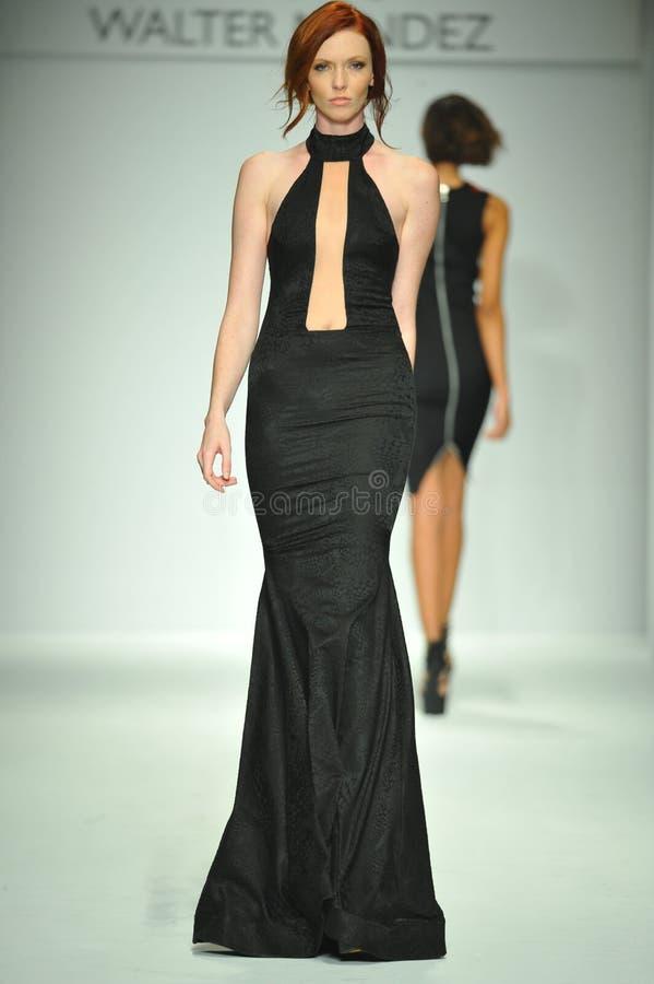 A model walks runway at Walter Mendez show stock photo