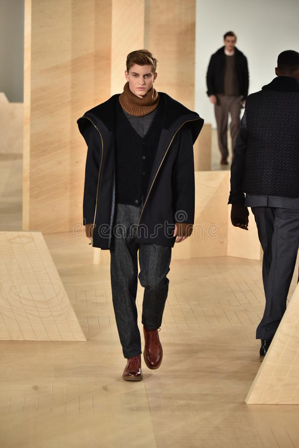 A model walks the runway wearing Perry Ellis during New York Fashion Week Men's Fall/Winter 2016. NEW YORK, NY - FEBRUARY 03: A model walks the runway wearing royalty free stock images