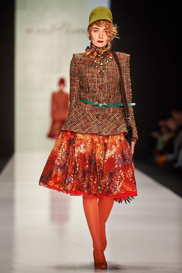 A model walks on the SLAVA ZAITSEV catwalk royalty free stock image