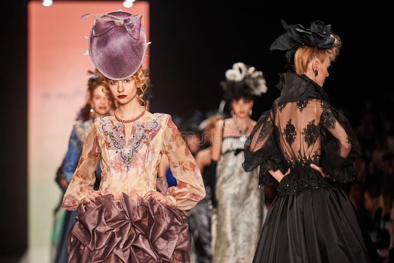 A model walks on the SLAVA ZAITSEV catwalk stock photo