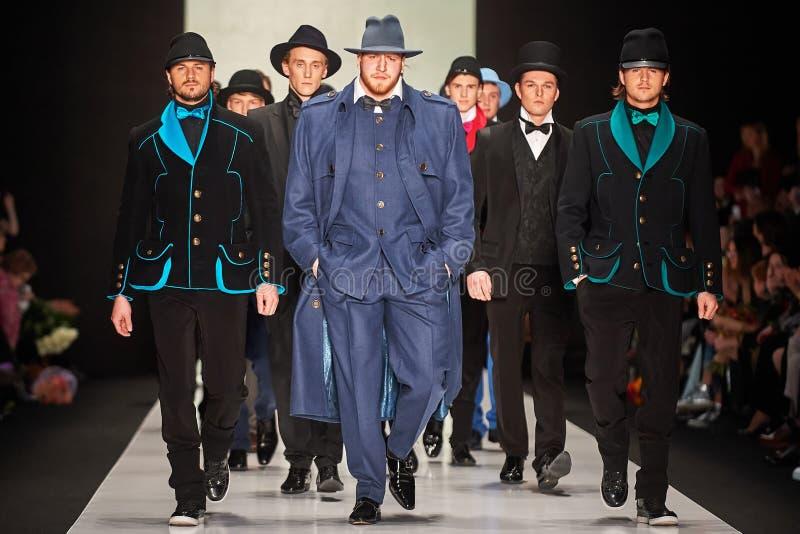 A model walks on the SLAVA ZAITSEV catwalk stock image