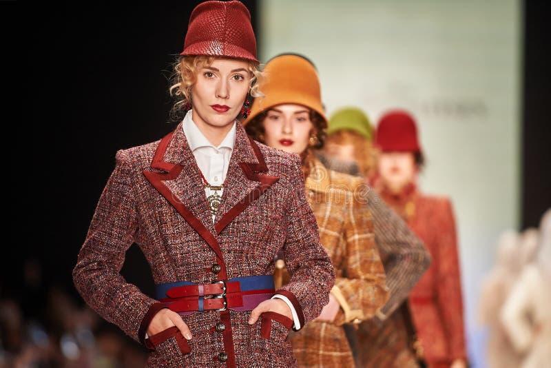 A model walks on the SLAVA ZAITSEV catwalk stock images