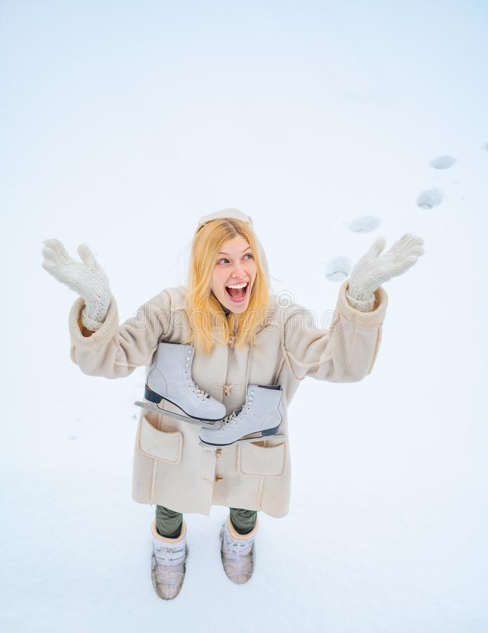 Model wearing stylish knitted winter hat and gloves. Funny young woman in the winter time. Winter holiday. Beautiful royalty free stock photo