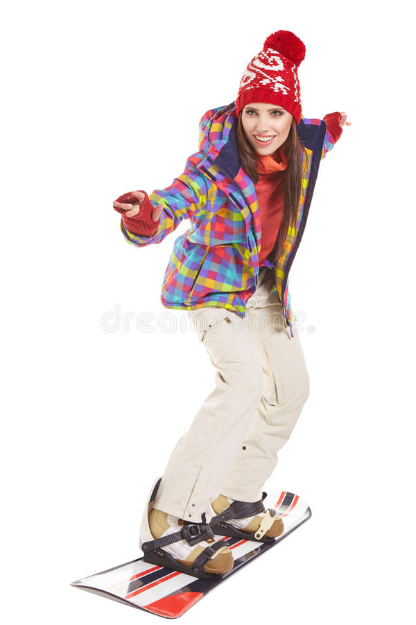 Model wearing winter suit holding a snowboard. Model wearing snowboard suit holding a snowboard in studio stock image