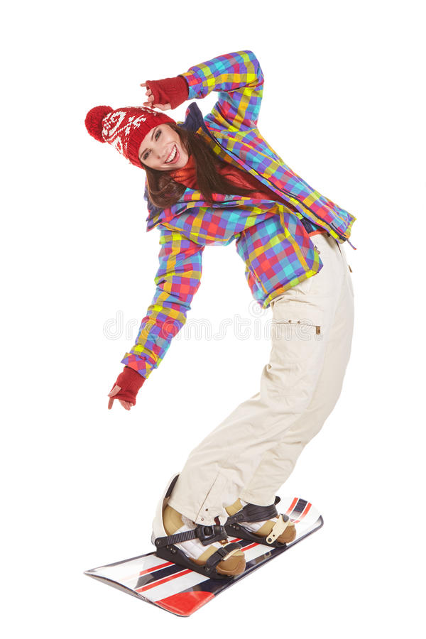 Model wearing winter suit holding a snowboard. Model wearing snowboard suit holding a snowboard in studio stock images