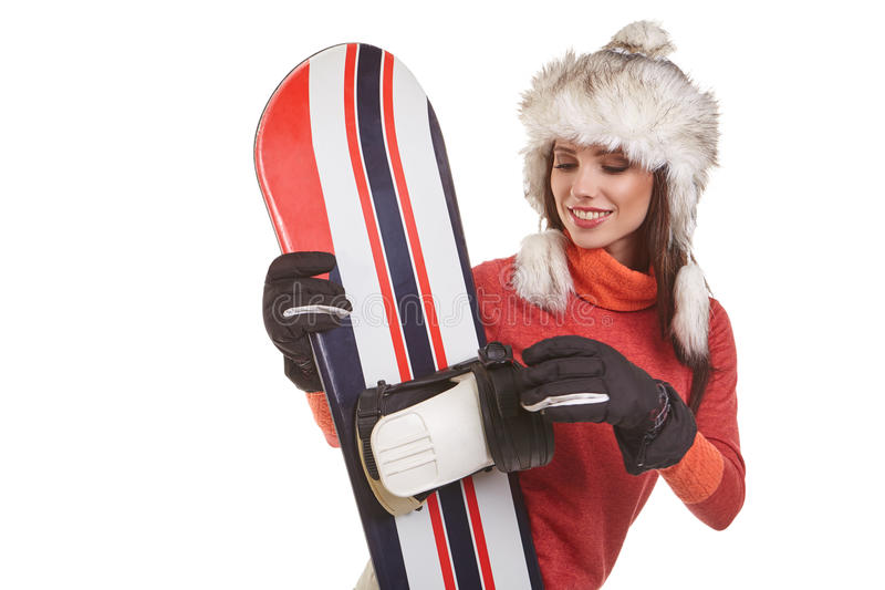 Model wearing winter suit holding a snowboard. Model wearing snowboard suit holding a snowboard in studio royalty free stock photo